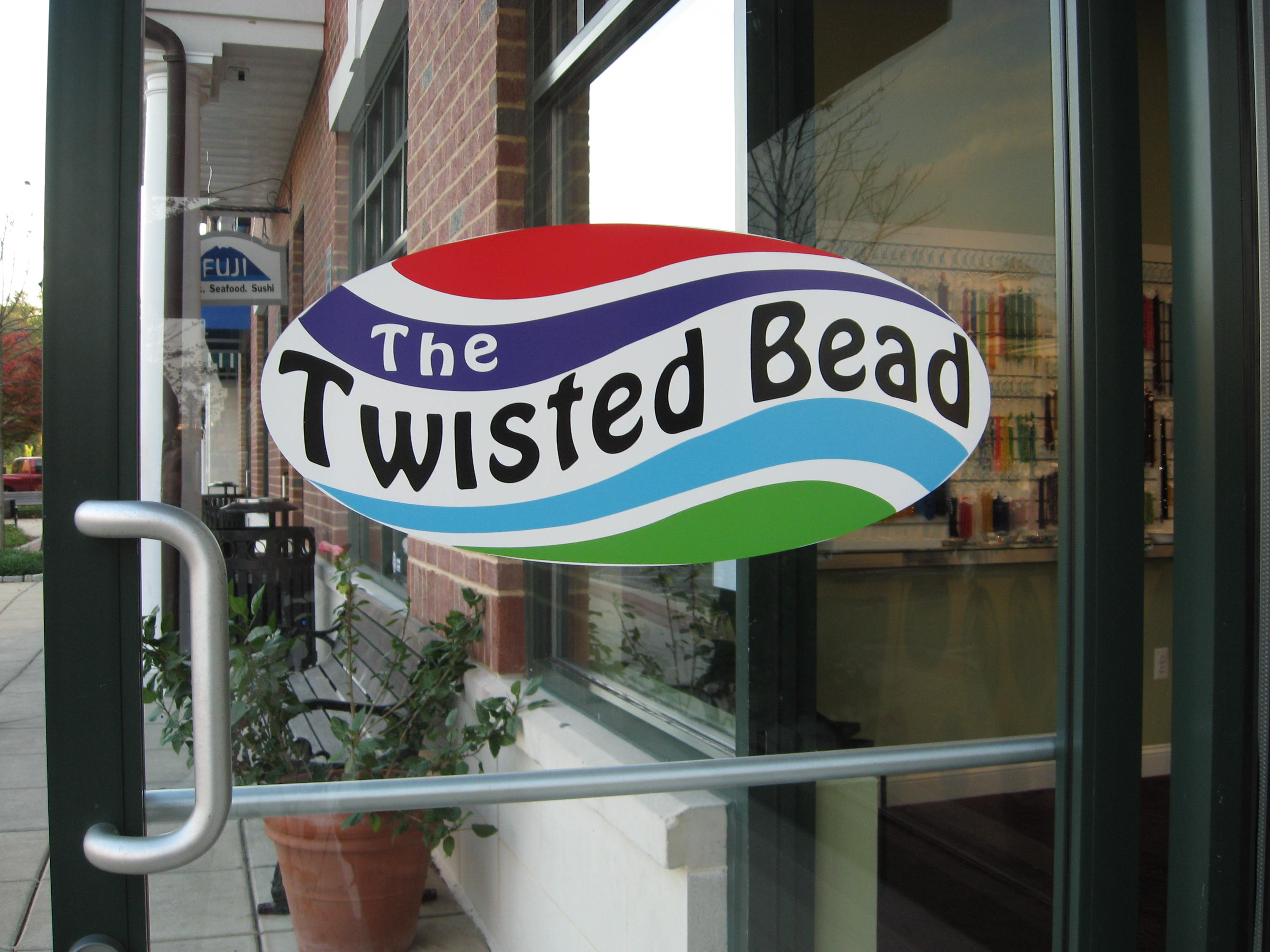 The Twisted Bead & Rock Shop door and logo.