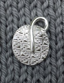 A precious metal clay pendant designed by Cindy May. Read more on our About Us page.