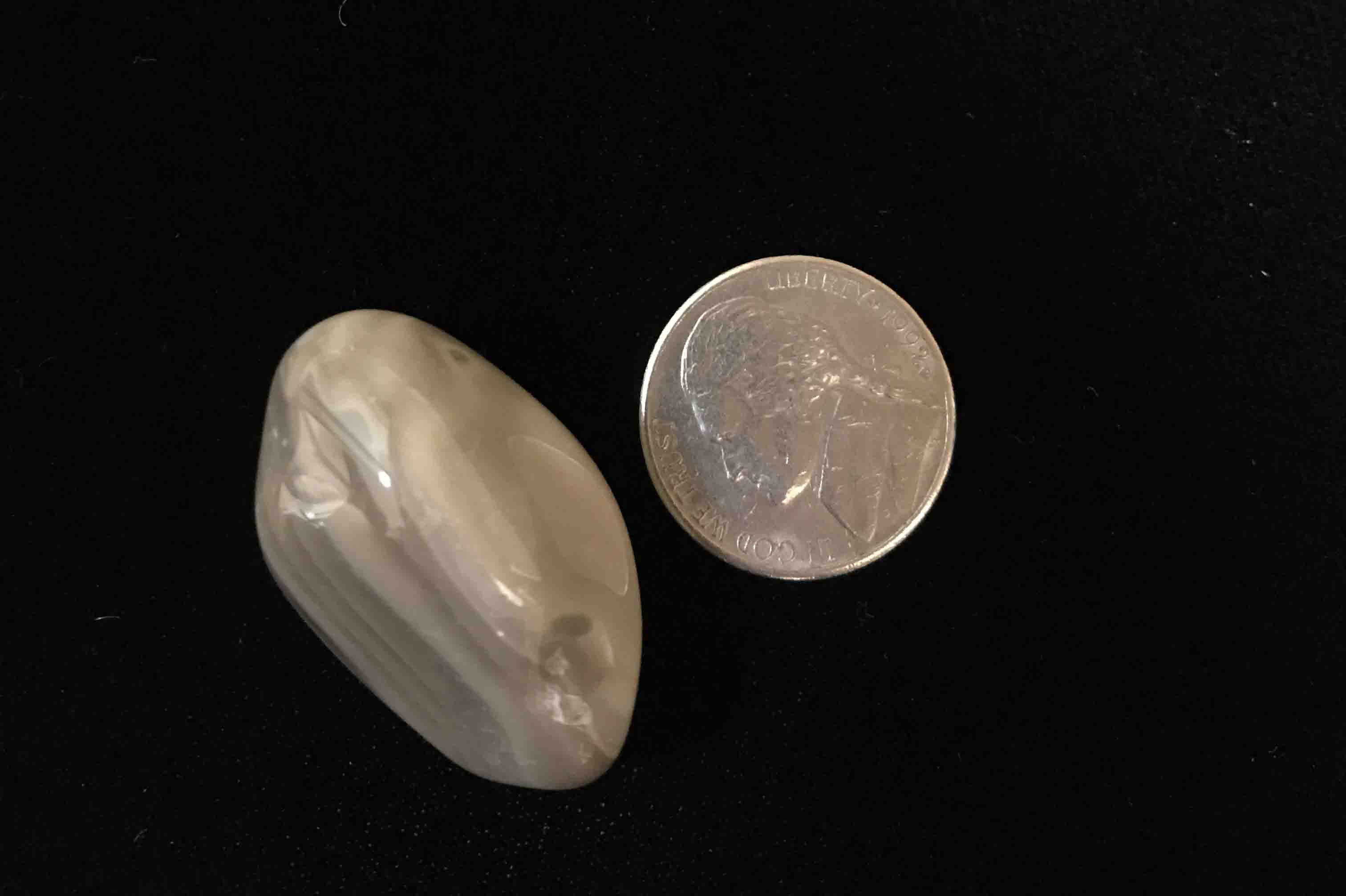Comparing size of Flint stone to a nickel