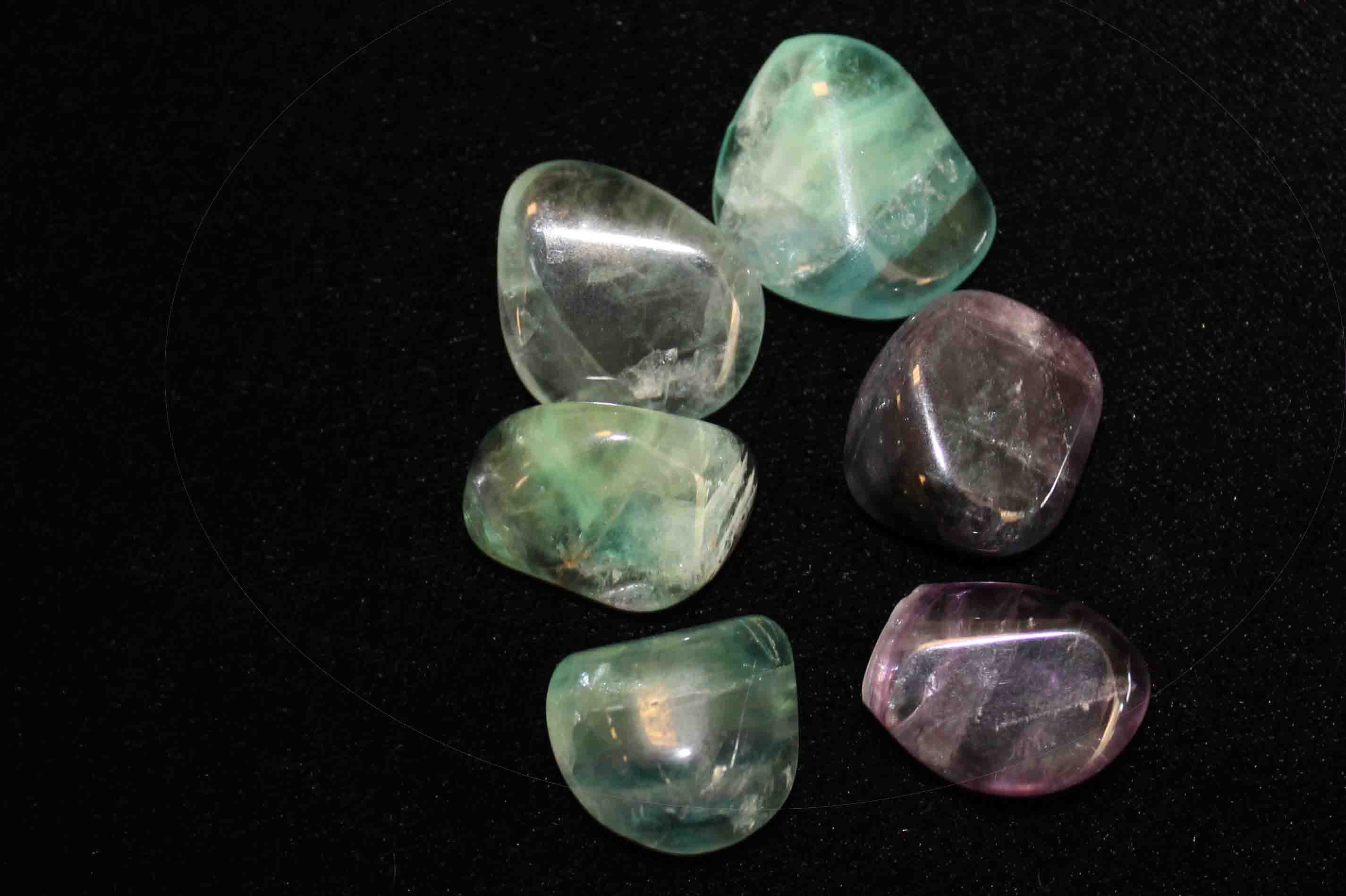 Tumbled fluorite stones in a variety of colors.