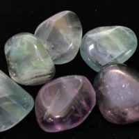 Tumbled fluorite stone in a variety of colors.